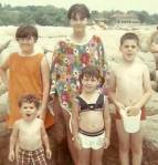 That's me in the flowered poncho.  The baby brother is the adorable little curly haired guy to my right.  Weren't we cute?